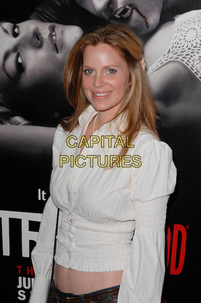 "KRISTIN BAUER .arriving at the Los Angeles premiere of Season 2 of the HBO series ""True Blood"" on the backlot at Paramount Pictures Studio in Hollywood, California, USA, June 9th 2009..half length white shirt midriff cropped puff shoulders sleeves .CAP/ROT.©Lee Roth/Roth Stock/Capital Pictures."