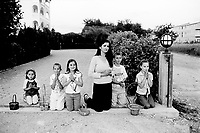 Bosnia. Medjugorje. God's (Jesus Christ) celebration on may 30. Religious procession on Corpus Christi day. A mother and her five children (boys and girls) pray on their knees. © 2002 Didier Ruef