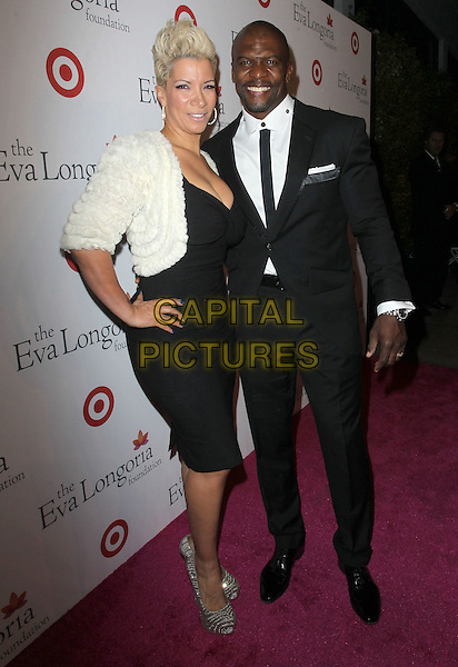 Rebecca Crews, Terry Crews<br /> Annual Eva Longoria Foundation Dinner held a Beso Restaurant, Hollywood, CA., USA.<br /> September 28th, 2013<br /> full length black suit tie dress white fur jacket married husband wife <br /> CAP/ADM/KB<br /> &copy;Kevan Brooks/AdMedia/Capital Pictures