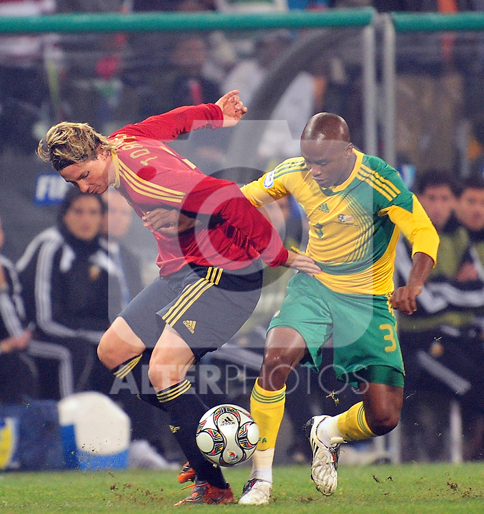Torres and Tsepo Masilela  during the soccer match of the 2009 Confederations Cup between Spain and South Africa played at the Freestate Stadium,Bloemfontein,South Africa on 20 June 2009.  Photo: Gerhard Steenkamp/Superimage Media.