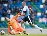 Kenny Miller rounds Roy Carroll to score his second and Rangers third goal of the match