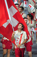 Aug. 8, 2008; Beijing, CHINA; Roger Federer carries the Swiss flag during the opening ceremonies for the 2008 Beijing Olympic Games at the National Stadium. Mandatory Credit: Mark J. Rebilas-