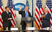 United States President Donald J. Trump departs after making remarks at the first meeting of the Presidential Advisory Commission on Election Integrity, flanked by the Commissions Vice Chair Chris Kobach (left) and Chairman, US Vice President Mike Pence (right) at The White House in Washington, DC, July 19, 2017.<br /> Credit: Chris Kleponis / CNP