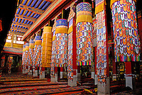 Hanging, embroidered, silk tasseled banners, or ka-phan in Tibetan, adorn some of the 183 columns in the Main Assembly Hall, or tsogchen, at Drepung Monastery, Lhasa, Tibet, China..