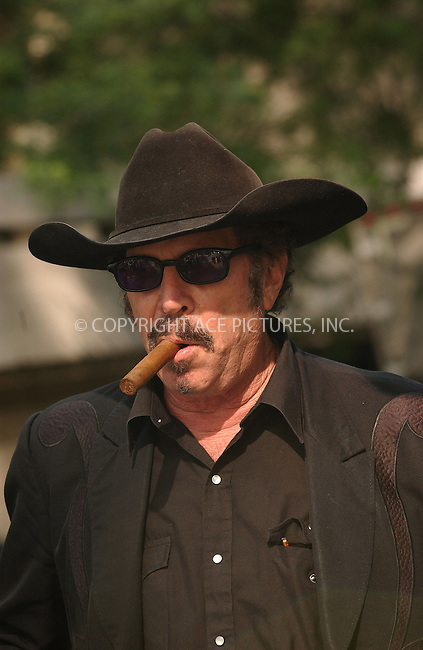 WWW.ACEPIXS.COM . . . . . ....NEW YORK, JUNE 20, 2005....Kinky Friedman talking a walk in New York.  As always he's got a cigar ready to go.....Please byline: KRISTIN CALLAHAN - ACE PICTURES.. . . . . . ..Ace Pictures, Inc:  ..Craig Ashby (212) 243-8787..e-mail: picturedesk@acepixs.com..web: http://www.acepixs.com