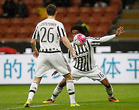 Calcio, Coppa Italia: semifinale di ritorno Inter vs Juventus. Milano, stadio San Siro, 2 marzo 2016. <br /> Juventus&rsquo; Juan Cuadrado, right, in action past his teammate Stephan Lichsteiner during the Italian Cup second leg semifinal football match between Inter and Juventus at Milan's San Siro stadium, 2 March 2016.<br /> UPDATE IMAGES PRESS/Isabella Bonotto