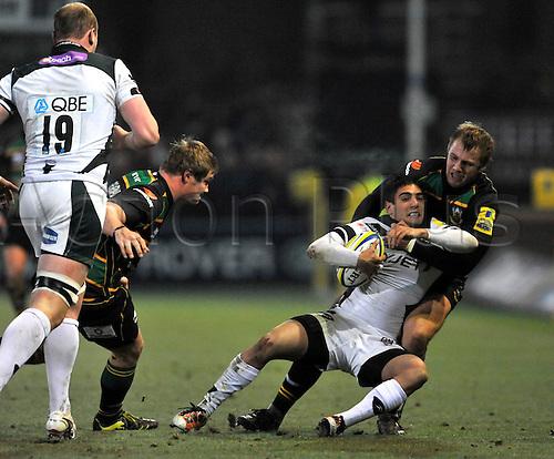 26.11.10. Roger Wilson of Northampton Saints tackles Daniel Bowden of London Irish. Aviva Premiership Rugby Round 9 Northampton Saints vs London Irish at Franklin s Gardens, Northampton, England