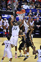 Yancy Gates of the Bearcats tries to contain the loose ball. Cincinnati defeated Missouri 78-63 during the NCAA tournament at the Verizon Center in Washington, D.C. on Thursday, March 17, 2011. Alan P. Santos/DC Sports Box