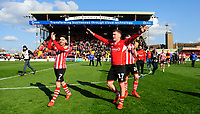 Lincoln City's Tom Pett, left, with team-mate Shay McCartan celebrate after securing promotion from Sky Bet League Two<br /> <br /> Photographer Chris Vaughan/CameraSport<br /> <br /> The EFL Sky Bet League Two - Lincoln City v Cheltenham Town - Saturday 13th April 2019 - Sincil Bank - Lincoln<br /> <br /> World Copyright © 2019 CameraSport. All rights reserved. 43 Linden Ave. Countesthorpe. Leicester. England. LE8 5PG - Tel: +44 (0) 116 277 4147 - admin@camerasport.com - www.camerasport.com