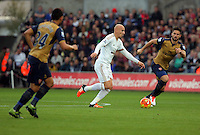 Jonjo Shelvey of Swansea (C) during the Barclays Premier League match between Swansea City and Arsenal at the Liberty Stadium, Swansea on October 31st 2015