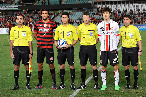 07.04.2015. Sydney, Australia. AFC Champions League. Western Sydney Wanderers v FC Seoul.Wanderers captain Topor-Stanley and Seoul captain Koh Myong-jin lineup before kickoff.