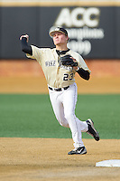 Wake Forest Demon Deacons shortstop Jimmy Redovian (23) makes a throw to first base against the Marshall Thundering Herd at Wake Forest Baseball Park on February 17, 2014 in Winston-Salem, North Carolina.  The Demon Deacons defeated the Thundering Herd 4-3.  (Brian Westerholt/Four Seam Images)