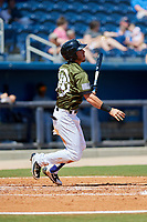 Biloxi Shuckers shortstop Dylan Moore (18) follows through on a swing during a game against the Jacksonville Jumbo Shrimp on May 6, 2018 at MGM Park in Biloxi, Mississippi.  Biloxi defeated Jacksonville 6-5.  (Mike Janes/Four Seam Images)