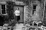 Upper Slaughter, Gloucestershire 1975. England. Post office the post mistress Mrs Eales.