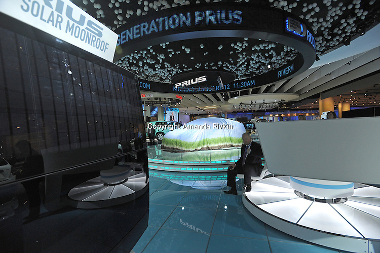 A man sits in the Toyota showroom before the unveiling of a new hybrid Prius at the Detroit Auto Show in Detroit, Michigan on January 11, 2009.