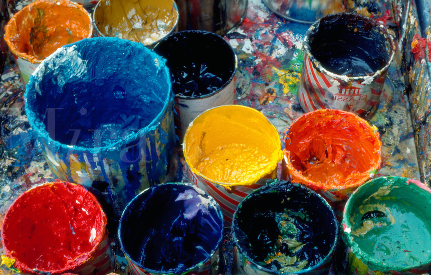 Colorful shot of many pots of paint.