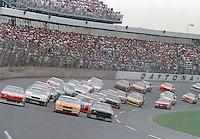 Dale Earnhardt (#3) leads the field down the front straightaway at Daytona to start the 1990 Pepsi 400.  Earnhardt went on to win the race. (Photo by Brian Cleary/www.bcpix.com)