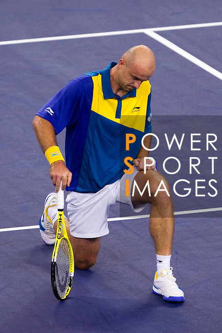SHANGHAI, CHINA - OCTOBER 13:  Ivan Ljubicic of Croatia reacts after loosing a point against Novak Djokovic of Serbia during day three of the 2010 Shanghai Rolex Masters at the Shanghai Qi Zhong Tennis Center on October 13, 2010 in Shanghai, China.  (Photo by Victor Fraile/The Power of Sport Images) *** Local Caption *** Ivan Ljubicic