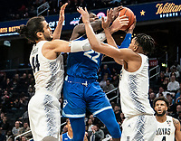 WASHINGTON, DC - FEBRUARY 05: Jamorko Pickett #1 and Omer Yurtseven #44 of Georgetown battle for the ball with Myles Cale #22 of Seton Hall during a game between Seton Hall and Georgetown at Capital One Arena on February 05, 2020 in Washington, DC.