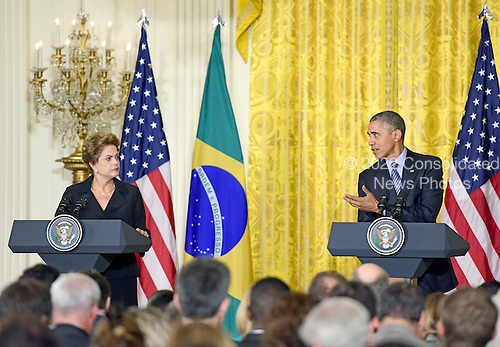 United States President Barack Obama, right, holds a joint press conference with President Dilma Rousseff of Brazil, left, in the East Room of the White House in Washington, D.C. on Tuesday, June 30, 2015.<br /> Credit: Ron Sachs / CNP