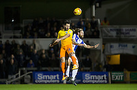 Sam Wood of Wycombe Wanderers beats Stuart Sinclair of Bristol Rovers in the air during the Sky Bet League 2 rearranged match between Bristol Rovers and Wycombe Wanderers at the Memorial Stadium, Bristol, England on 1 December 2015. Photo by Andy Rowland.