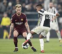 Football Soccer: UEFA Champions League Juventus vs FC Barcelona Allianz Stadium. Turin, Italy, November 22, 2017. <br /> Juventus' Alex Sandro (r) in action with FC Barcelona's Ivan Rakitic  (l) during the Uefa Champions League football soccer match between Juventus and FC Barcelona at Allianz Stadium in Turin, November 22, 2017.<br /> UPDATE IMAGES PRESS/Isabella Bonotto