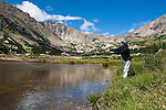 woman flyfishing at Lawn Lake below Fairchild Mountain, summer, August, Rocky Mountain National Park, Colorado, USA, (MR) model released #93