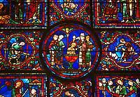 Medieval Windows of the Gothic Cathedral of Chartres, France, dedicated to St Martin of Tour.    A UNESCO World Heritage Site. In the  central oval panel St Martin is being baptised.
