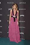 LOS ANGELES, CA - NOVEMBER 07: Model Rosie Huntington-Whiteley wearing Gucci attends LACMA 2015 Art+Film Gala Honoring James Turrell and Alejandro G Iñárritu, Presented by Gucci at LACMA on November 7, 2015 in Los Angeles, California.