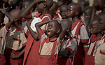 A girl yawns as students assemble at the beginning of the school day at the Loreto Primary School outside Rumbek, South Sudan. The school is run by the Institute for the Blessed Virgin Mary--the Loreto Sisters--of Ireland.