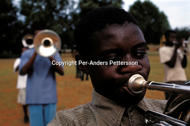 dieduca00257 Education/ Disable/ Blind KLIPRIVER, SOUTH AFRICA APRIL 13: (GERMANY OUT) John Milolo, age 14, a blind boy, play the trumpet in a brass band on April 13, 2003 at Sibonile (means: we have seen) School for the Blind in Klipriver, south of Johannesburg, South Africa. A Johannesburg music group visits them about once a month giving the children a chance to play instruments and dance. A blind woman founded the school in 1994. The school has about 125 students from disadvantaged communities around South Africa. Many of the children have faced rejection from their families and communities, and at Sibonile they have a chance for a good education. .(Photo: Per-Anders Pettersson/iAfrika Photos)...