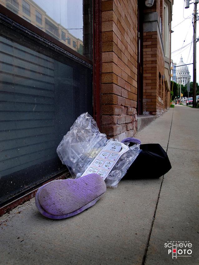 Slippers on the sidewalk.