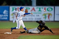 Bluefield Blue Jays shortstop Rafael Lantigua (25) turns a double play as Francisco Mepris (54) slides into second base during a game against the Bristol Pirates on July 26, 2018 at Bowen Field in Bluefield, Virginia.  Bristol defeated Bluefield 7-6.  (Mike Janes/Four Seam Images)