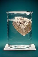 PUMICE FLOATING IN A BEAKER OF WATER<br />
