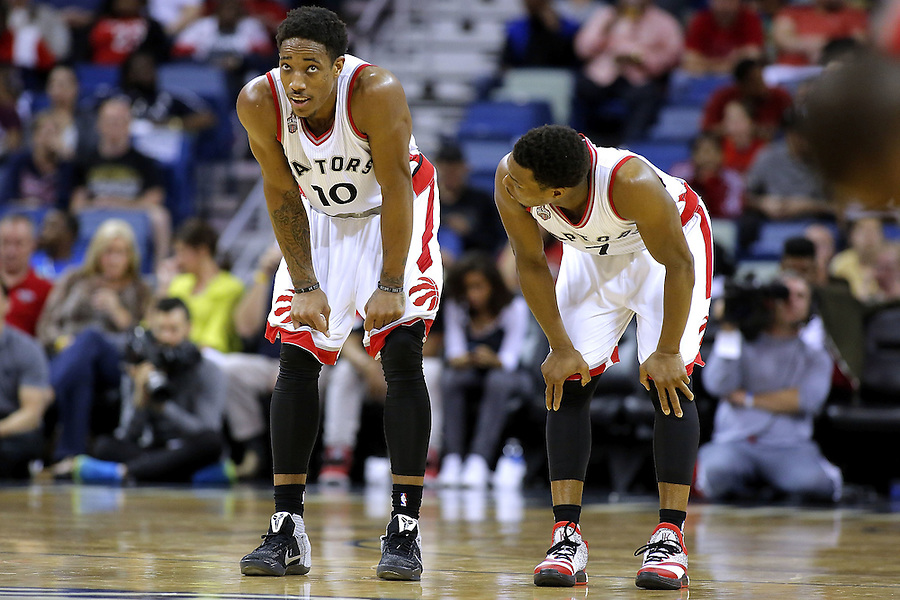 NEW ORLEANS, LA - MARCH 26:  DeMar DeRozan #10 of the Toronto Raptors and Kyle Lowry #7 of the Toronto Raptors react during a game at the Smoothie King Center on March 26, 2016 in New Orleans, Louisiana. NOTE TO USER: User expressly acknowledges and agrees that, by downloading and or using this photograph, User is consenting to the terms and conditions of the Getty Images License Agreement.  (Photo by Jonathan Bachman/Getty Images)