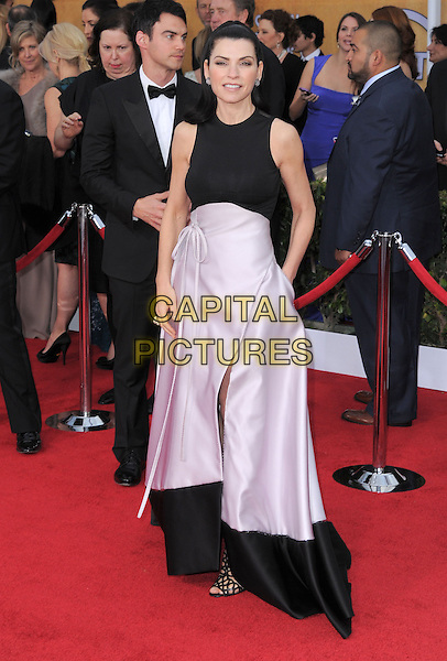 Julianna Margulies.Arrivals at the 19th Annual Screen Actors Guild Awards at the Shrine Auditorium in Los Angeles, California, USA..27th January 2013.SAG SAGs full length black white sleeveless pink skirt hand in pocket .CAP/DVS.©DVS/Capital Pictures.
