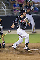 Trey Michalczewski (27) of the Kannapolis Intimidators follows through on his swing against the Asheville Tourists at CMC-NorthEast Stadium on July 12, 2014 in Kannapolis, North Carolina.  The Tourists defeated the Intimidators 7-5 in 15 innings.  (Brian Westerholt/Four Seam Images)