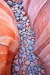 Abstract view of cobblestone and striated sandstone near the White Domes slot canyon at the Valley of Fire State Park, Nevada, USA
