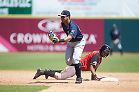 Charleston RiverDogs shortstop Wilkerman Garcia (24) reaches for a throw as Jose Almonte (9) of the Hickory Crawdads slides back into second base at L.P. Frans Stadium on May 13, 2019 in Hickory, North Carolina. The Crawdads defeated the RiverDogs 7-5. (Brian Westerholt/Four Seam Images)