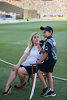 Commentator Laura McGoldrick and a lucky young fan during the Black Caps v Australia international T20 cricket match at Eden Park in Auckland, New Zealand. 16 February 2018. Copyright Image: Peter Meecham / www.photosport.nz