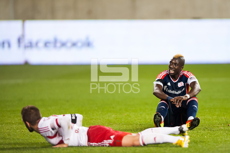 Saer Sene (39) of the New England Revolution sits on the ground after a failed scoring opportunity. The New York Red Bulls defeated the New England Revolution 4-1 during a Major League Soccer (MLS) match at Red Bull Arena in Harrison, NJ, on March 20, 2013.