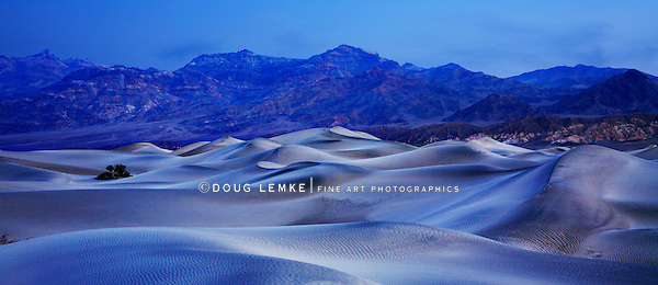Sand dunes and mountains in the predawn light at Stovepipe Wells, Death Valley National Park, California, USA