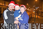 Oliver, Bibi and TJ Murphy, take time for a photo at the turning of the lights by santa in Abbeyfeale on Sunday....   Copyright Kerry's Eye 2008