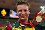 Australia's Heath Francis proudly displays his gold medal for a world record win in the men's T46 400m final