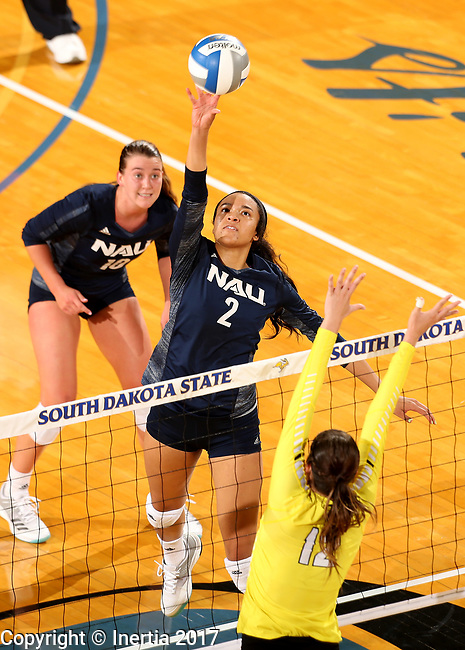 BROOKINGS, SD - SEPTEMBER 1: Victoria Ewalefo #2 from Northern Arizona tips the ball against Taylor Graboski #12 from Valparaiso during their match Friday afternoon at the Jackrabbit Invitational at Frost Arena in Brookings. (Photo by Dave Eggen/Inertia)