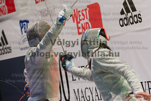 Aron Szilagyi (L) of Hungary and Kim Junghwan (R) of Korea fight during the final of the Gerevich-Kovacs-Karpati Men's Sabre Grand Prix in Budapest, Hungary on March 09, 2014. ATTILA VOLGYI