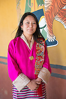Bhutan, Paro. Woman at Paro Rinpung Dzong.
