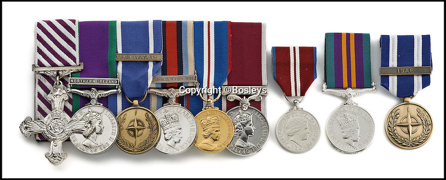 BNPS.co.uk (01202 558833)<br /> Pic: Bosleys/BNPS<br /> <br /> L-R: Distinguished Flying Cross, Campaign Service Medal, NATO Service Medal, Operational Service Medal, EIIR Golden Jubilee Medal, Army Long Service Medal, EIIR Diamond Jubilee Medal, Accumilated Campaign Service Medal, NATO Service Medal. <br /> <br /> A British helicopter pilot who performed one of the most daring rescues of the Afghanistan war is selling his gallantry medal to raise 100,000 pounds.<br /> <br /> Captain Tom O'Malley flew his Apache chopper into a Taliban stronghold with two Royal Marines strapped to the side in a brave bid to save a fatally wounded comrade.<br /> <br /> The pilot flew the gun ship at 60mph and just 20ft above the ground into the heavily defended Talban fort.<br /> <br /> The two marines jumped down and rescued Royal Marine Lance Corporal Mathew Ford. Tragically he could not be saved from his injuries which had been caused by friendly fire.<br /> <br /> Capt O'Malley's Distinguished Flying Cross is being sold by auctioneers Bosleys of Marlow, Bucks, tomorrow (Weds).