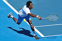 MELBOURNE, 15 JANUARY - Gael Monfils (FRA) misses a return of serve in the final of the 2011 AAMI Classic against Lleyton Hewitt (AUS) at Kooyong Tennis Club in Melbourne, Australia. (Photo Sydney Low / syd-low.com)