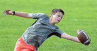 Chase Clemens catches a pass from Rasheed Bailey as he worked out with members of the Lenape Middle School football team Monday April 27, 2015 at Lenape Middle School in Doylestown, Pennsylvania. (Photo by William Thomas Cain/Cain Images)